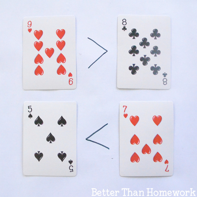Use playing cards to explore greater than and less than